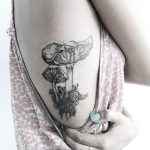 Mushrooms and snail tattoo