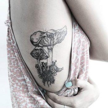Mushrooms and snail tattoo
