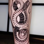 Mystical snake tattoo on the calf