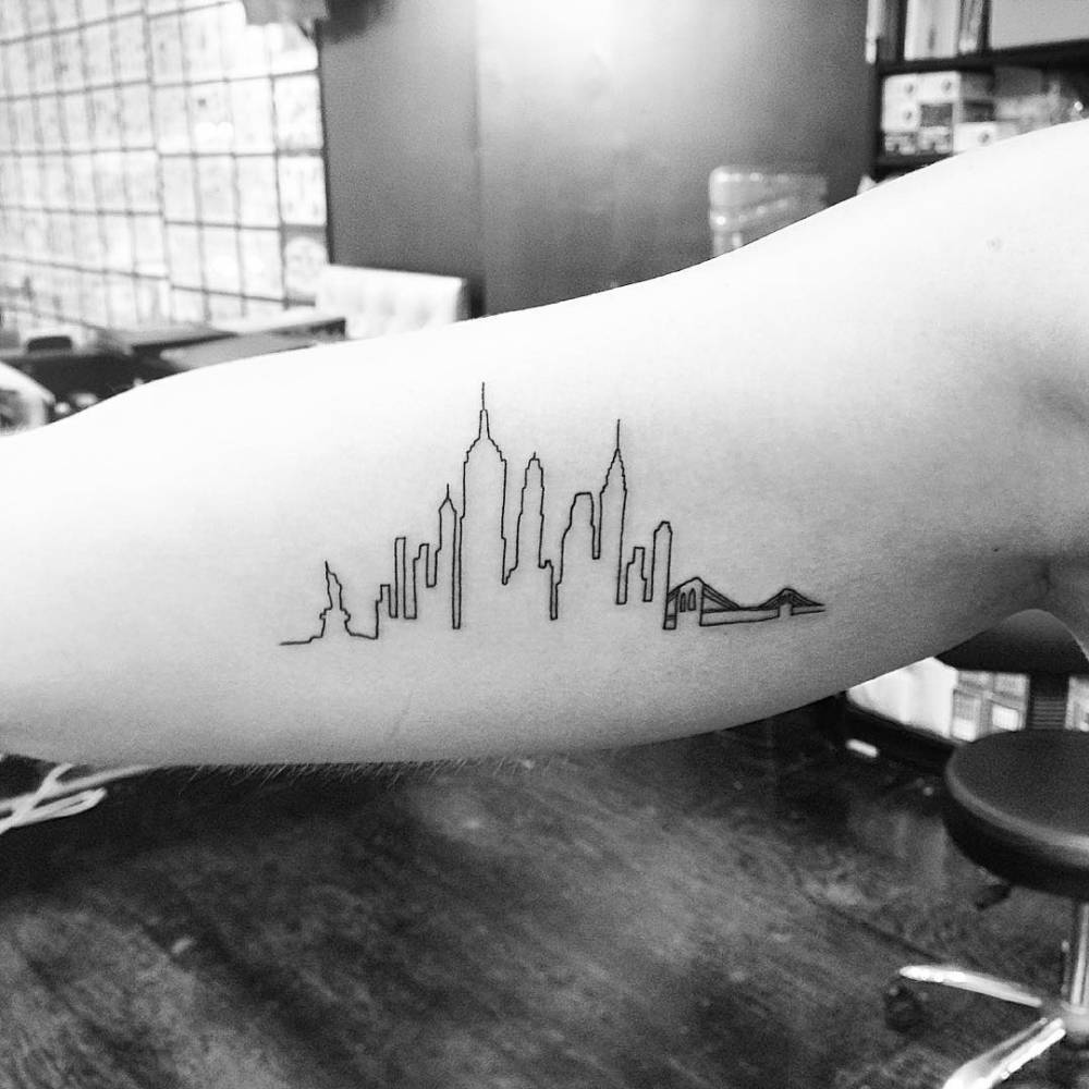 New York skyline tattoo on the forearm