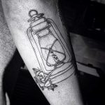 Old lamp and roses tattoo