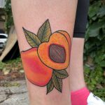 Peach tattoo on the right shin