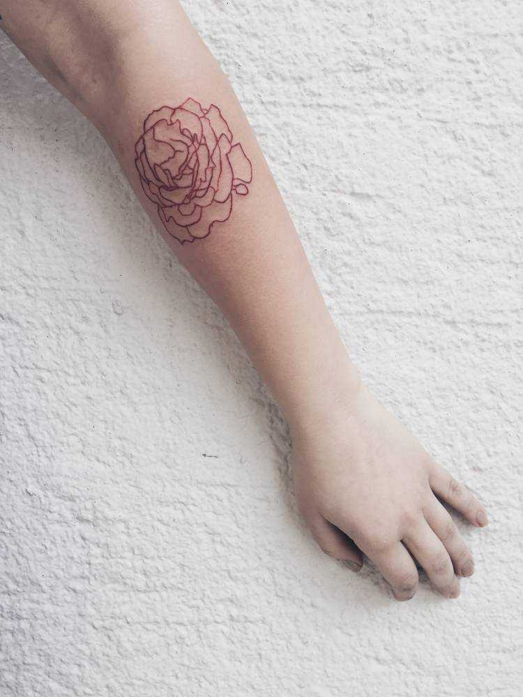 Red rose tattoo by Mina done at Backwards Tattoo
