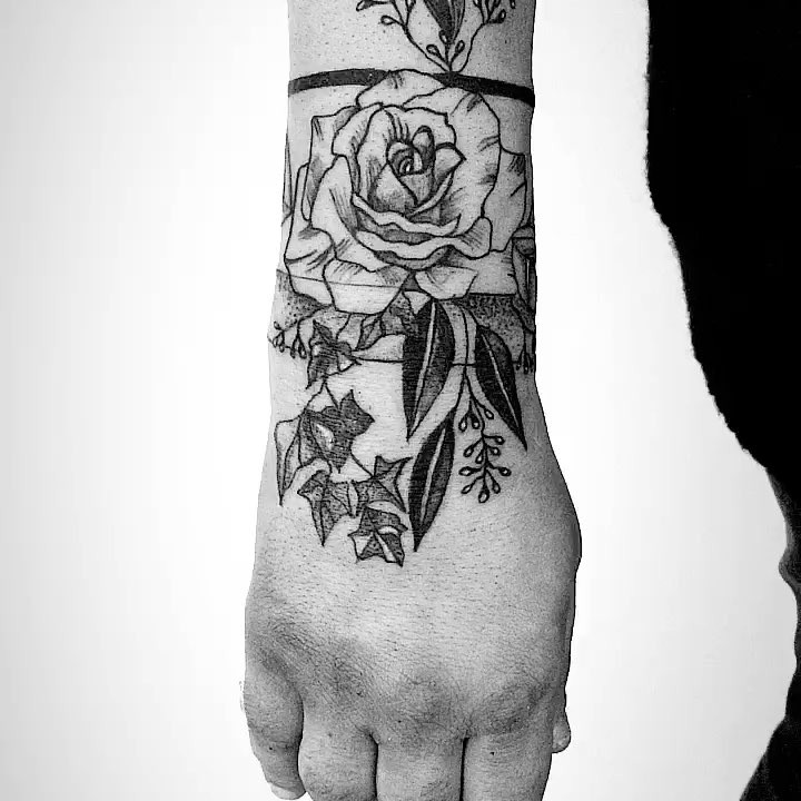 Rose inked around the right wrist