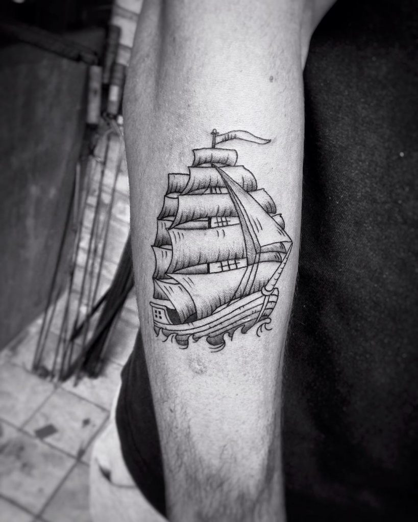Simple ship tattoo on the right forearm