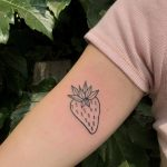 Simple sweetheart strawberry tattoo