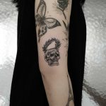 Skull with a laurel wreath tattoo