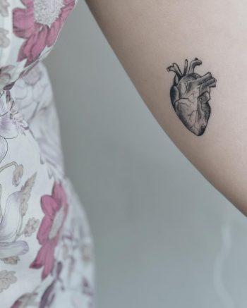 Small anatomical heart tattoo