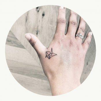 Small paper crane tattoo by Cholo