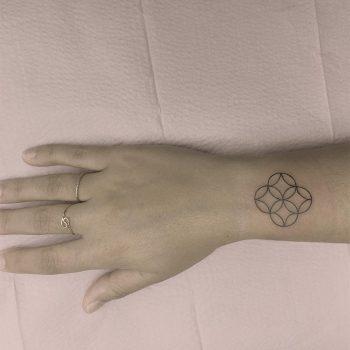 Small sacred geometry tattoo on the wrist