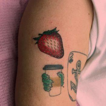 Small strawberry tattoo by Jen Wong