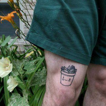 Smiling cacti pot tattoo