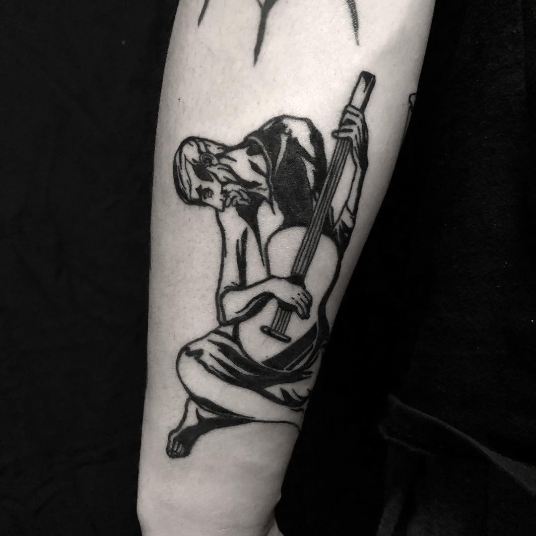 The old guitarist tattoo done at BK Ink Studio