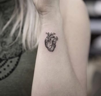 Tiny anatomical heart tattoo on the wrist