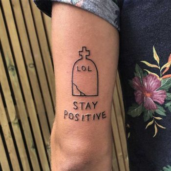 Tombstone and quote tattoo