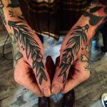 Traditional branches tattooed on thumbs