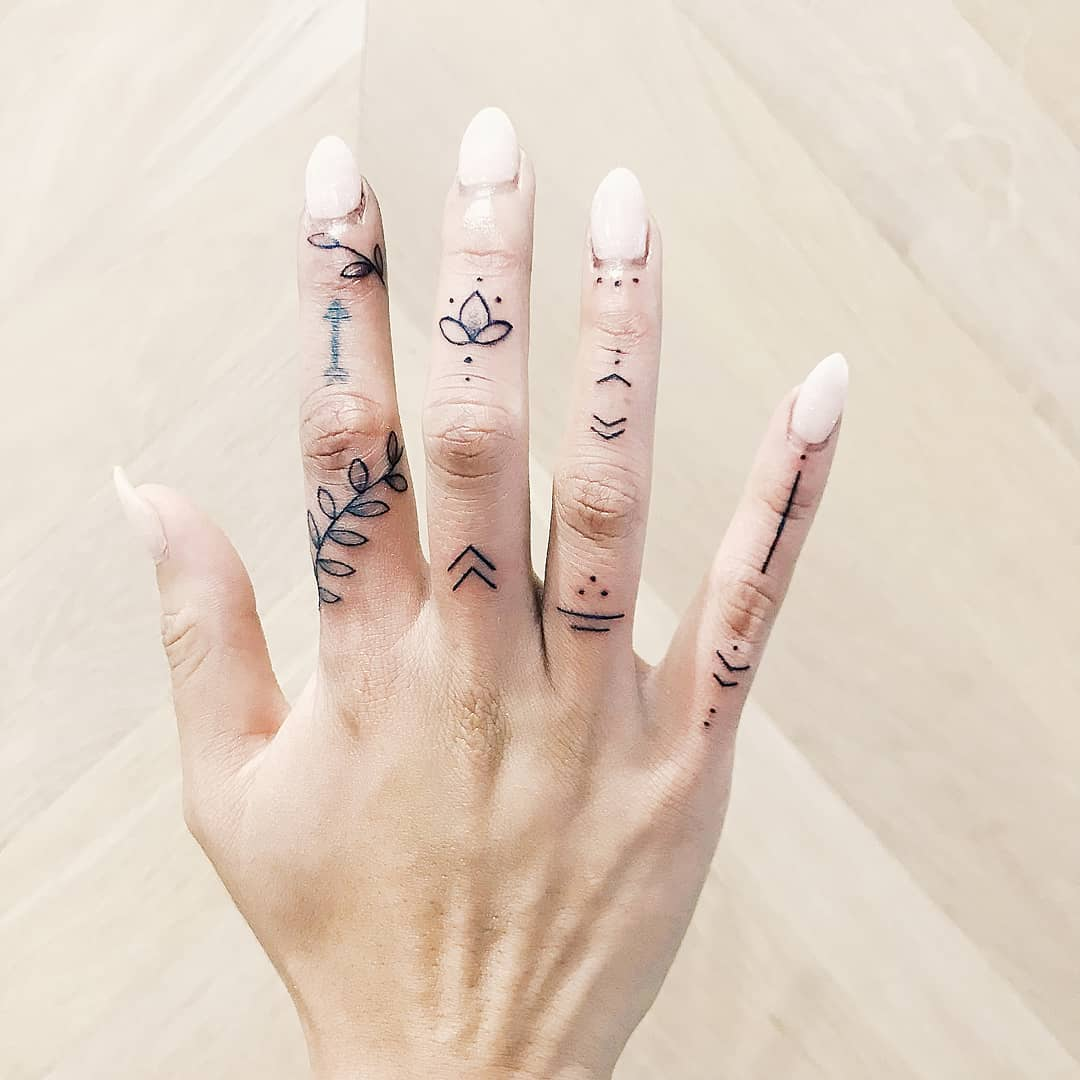 Various finger tattoos by artist Cholo