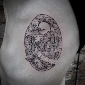 Warped western landscape tattoo