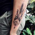 Wildflowers and rhombus landscape tattoo