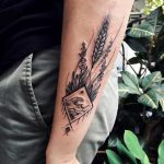 Wildflowers and rhombus landscape tattoo