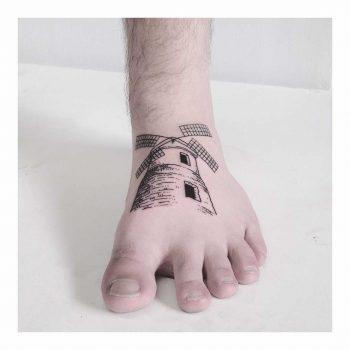 Windmill tattoo on the foot