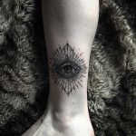 Witchy eye tattoo