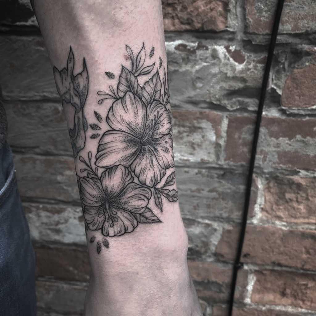 Wrapping blackwork hibiscus tattoo