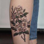 Apple blossoms tattoo on the shin