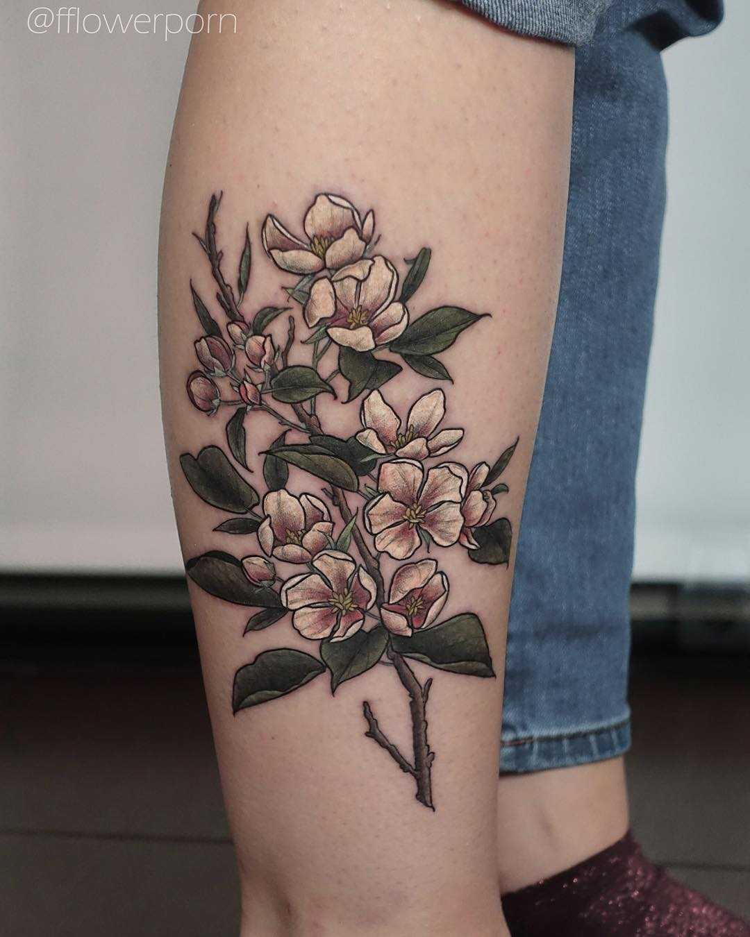 Apple blossoms tattoo on the shin
