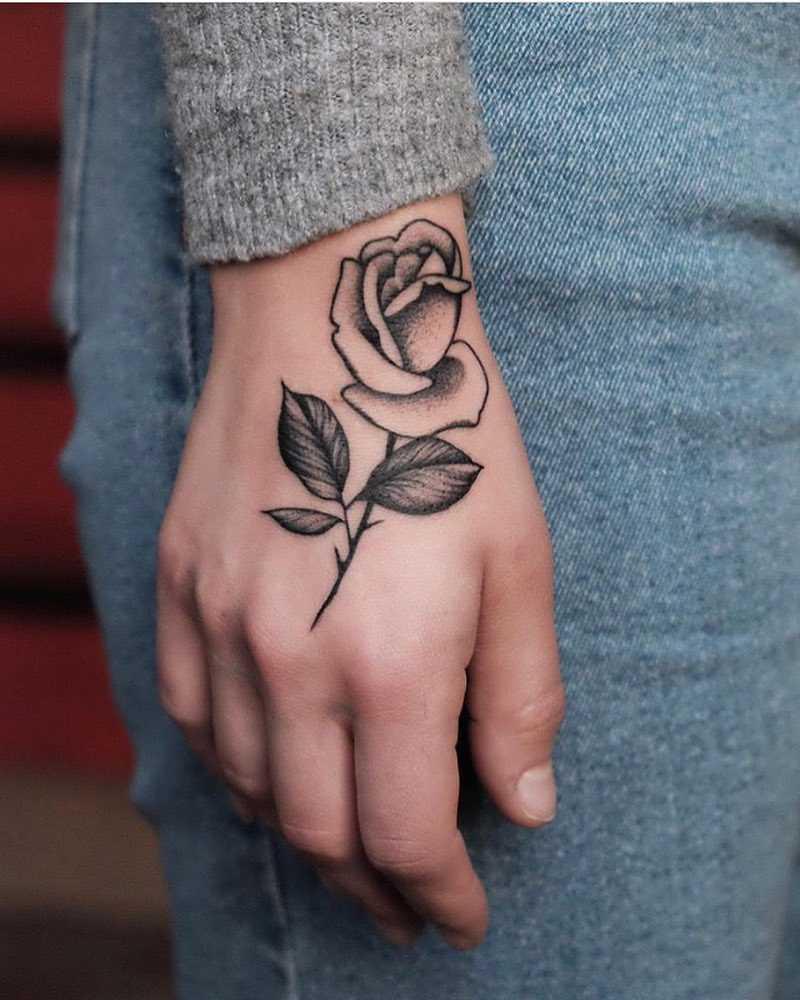 Beautiful grey rose tattoo by Roald Vd Broek