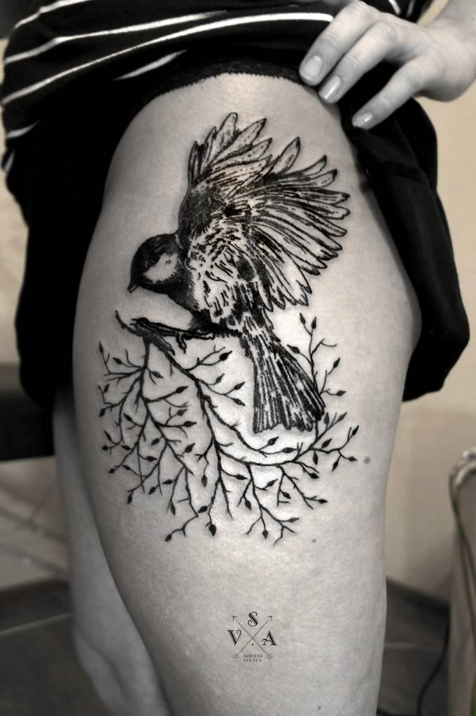Bird on a branch tattoo by Andrei Svetov