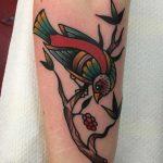 Bird on a branch tattoo by Jeroen Van Dijk