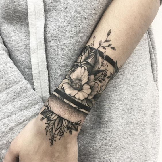 Black and grey floral armband tattoo