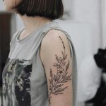 Black and grey wild flowers tattoo