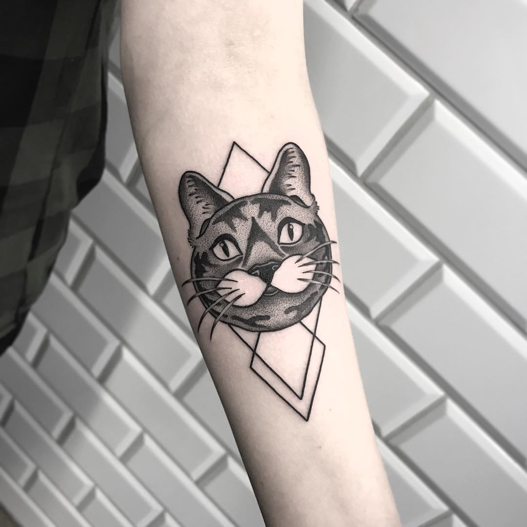 Black cat and rhombus tattoo