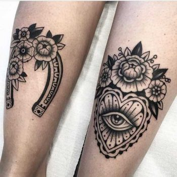 Black tattoos on calves by Arianna Fusini