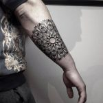 Blackwork ornamental mandala tattoo