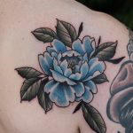Blue flower tattoo by Roald Vd Broek