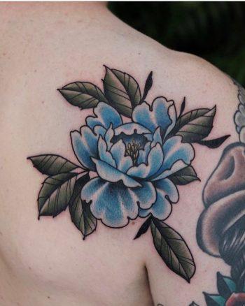 Blue flower tattoo by Roald Vd Broek