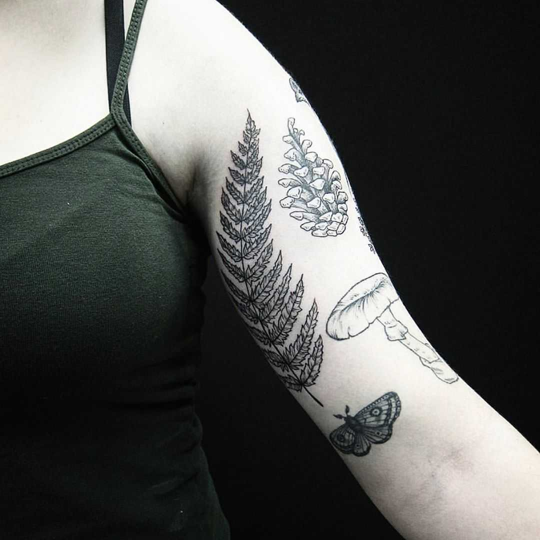 Botanical tattoos on the left arm