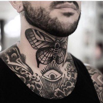 Butterfly tattoo on the neck by Jonas Ribeiro
