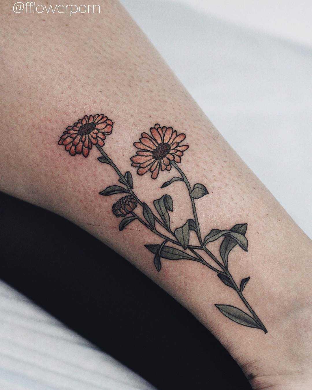 Calendula tattoo by Olga Nekrasova