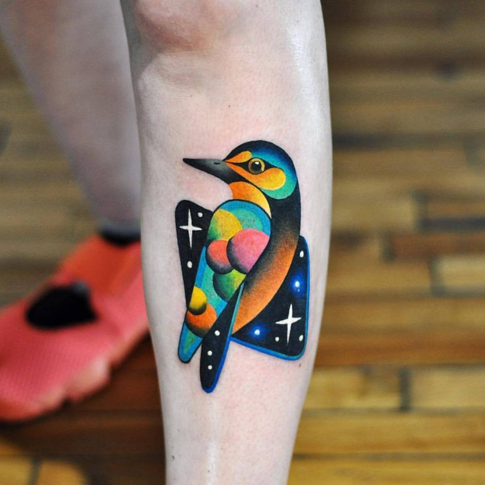Cosmic bird tattoo by David Côté