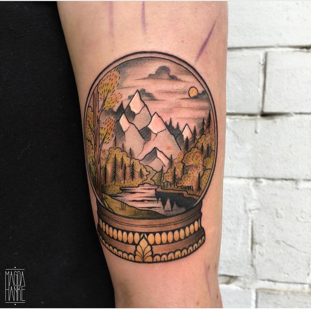 Crystal ball landscape tattoo by Magda Hanke