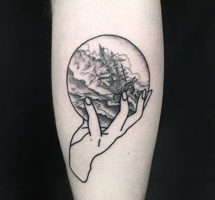 Crystal ball ocean tattoo by Russell Winter