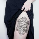 Custom floral patch tattoo by Dogma Noir
