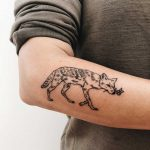 Cute fox tattoo on the forearm