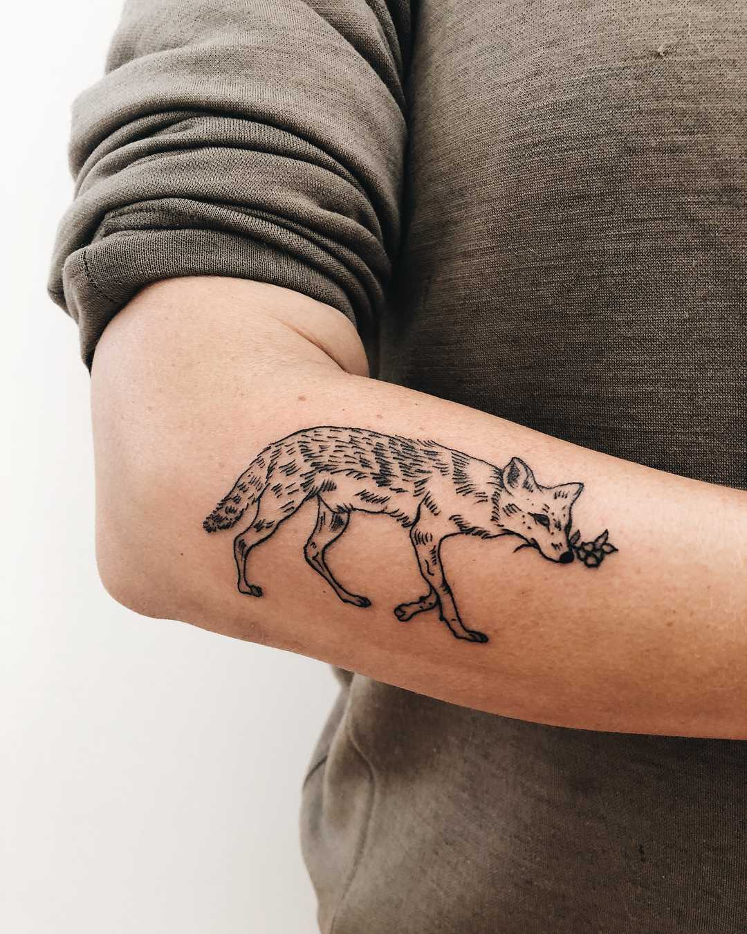 Cute fox tattoo on the forearm