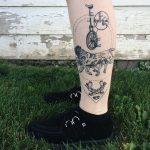English Mastiff and unicycle tattoo by Pony Reinhardt