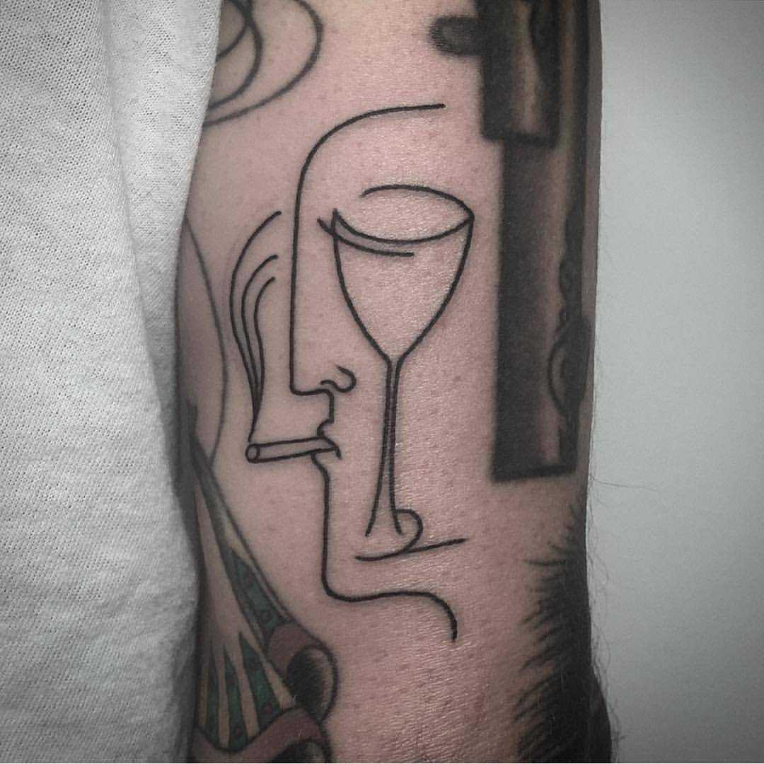 Face wine glass tattoo by Caleb Kilby